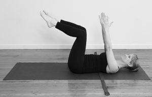 Yoga strap under mid back in supine